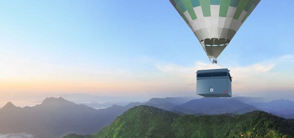Industrial air cleaner flying with a balloon over a clean mountain landscape