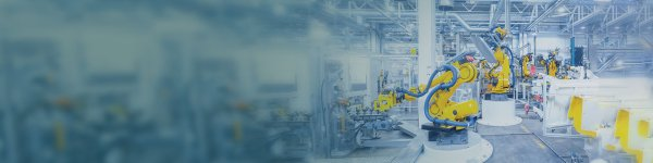 Robotic arms at work in an automotive production hall